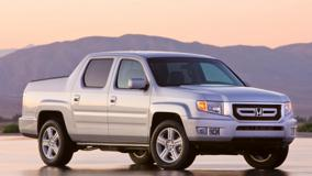 2009 Honda Ridgeline Side Pose In Silver Near Mountains